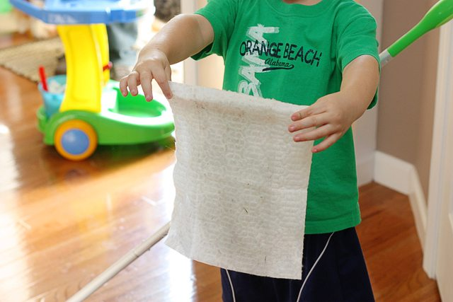 Jonah showing off his dirty Swiffer floor wipe! He was such a big helper.