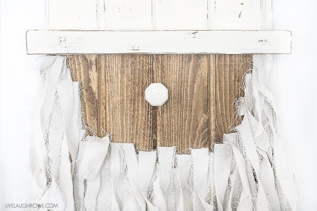 Add this Rustic Santa Door Hanger to your holiday decor -- it's simple to make and such a fun addition to your home or front door! livelaughrowe.com
