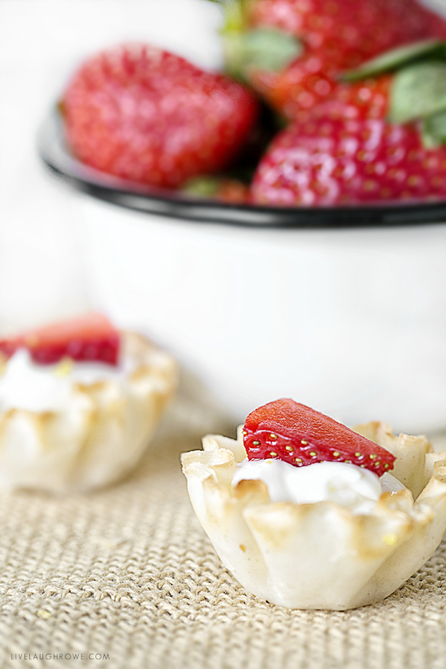 Lemon, cheese and berries make a delicious trio. These bite-size Lemon Cheesecake Tarts are guilt free way to satisfy your sweet tooth. Did I mention this is a Weight Watchers dessert with only one point per tart. Recipe at livelaughrowe.com