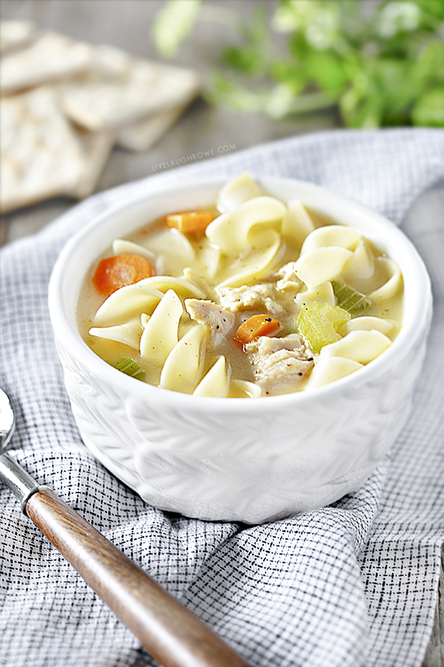 Bowl of Crockpot Chicken Noodle Soup, Napkin, Crackers and Spoon