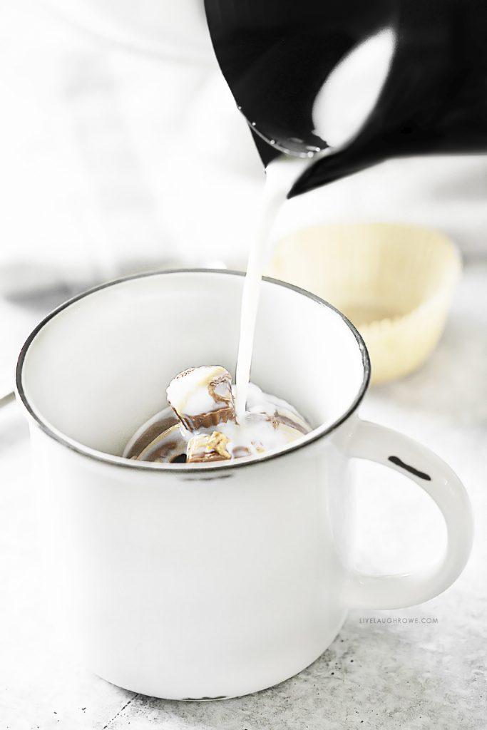 Pouring Milk over Cocoa Bomb