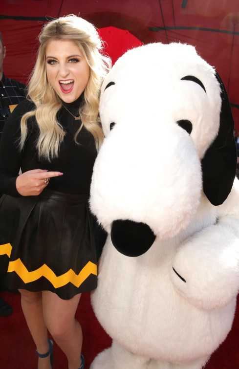 Meghan Trainor and Snoopy seen at Twentieth Century Fox Premiere of 'The Peanuts Movie' at Regency Village Theater on Sunday, November 1, 2015, in Los Angeles, CA. (Photo by Eric Charbonneau/Invision for Twentieth Century Fox/AP Images)