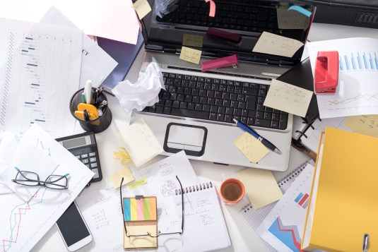 stuck in a rut - how to get unstuck - Messy and cluttered office desk