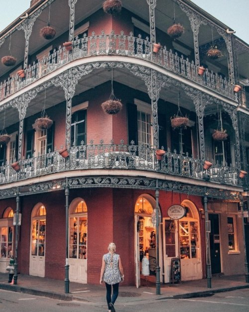 Red building with balconies in French Quarter in New Orleans that is popular in Instagram posts