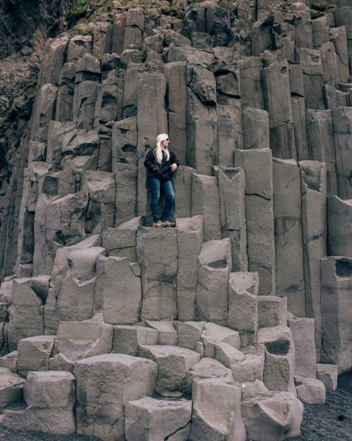 Standing on the Basalt columns at Reynisfajara Beach near Vik in Iceland. All the best photo spots in Iceland are here on our 6 day Iceland itinerary (get a free map too!)