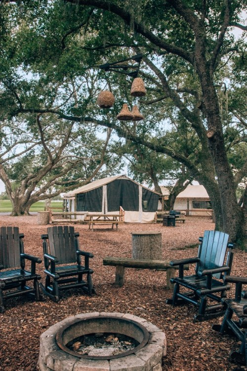 Glamping tent and fire pit at Westgate River Ranch