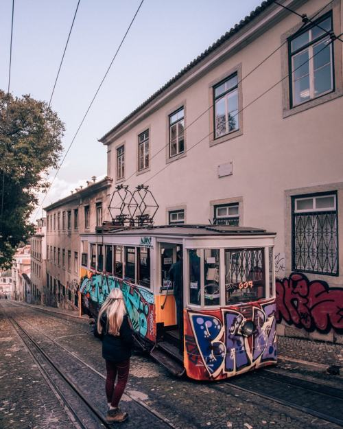 Ascensor da Gloria in Lisbon Portugal covered in graffiti. Find the most Instagrammable places in Lisbon, Portgual, here with a free map!