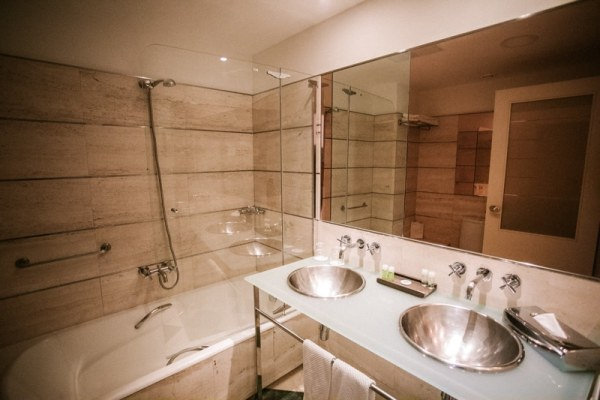 The bathroom in our hotel room at Barcelona Airport Hotel. Get a full guide to Barcelona in this 3 day itinerary.