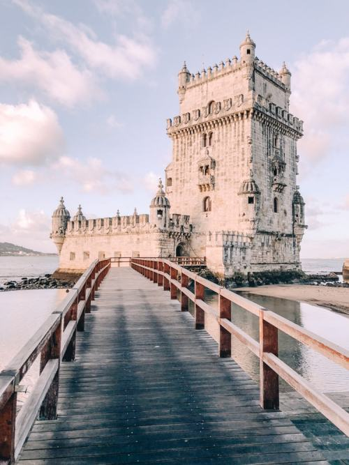 The bridge to Belem Tower near sunrise. Find a list of Lisbon's most Instagrammable photo locations plus Lisbon travel tips and a free map here.