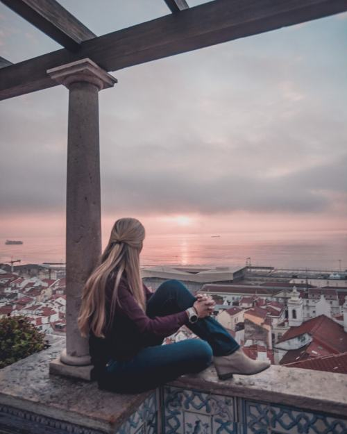 Sunrise at Miradouro de Santa Luzia in the Alfama District of Lisbon. Get a list of Lisbon's most Instagrammable spots here with a free map!