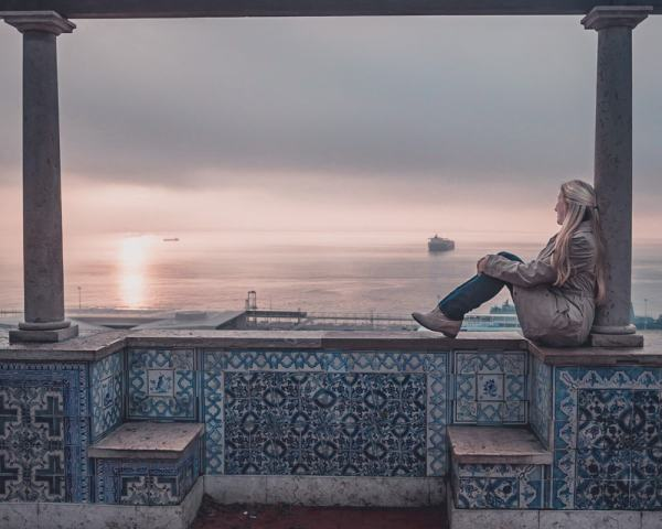 Sunrise at Miradouro de Santa Luzia. Check out this guide to the most Instagrammable places in Lisbon + a free map!