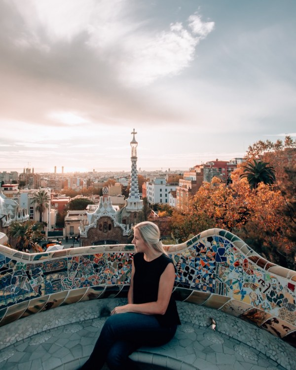 Sunrise view of Barcelona from Park Guell in Barcelona in the fall. Get a full travel guide to Barcelona including a 3 day itinerary with all the best photo spots here!