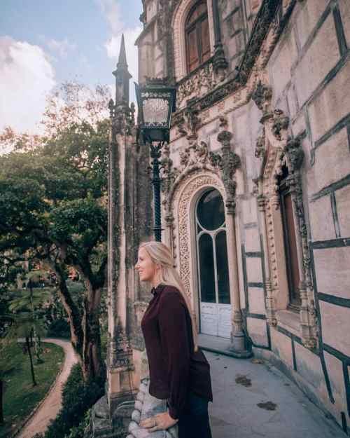 Woman on balcony at Quinta de Regaleira