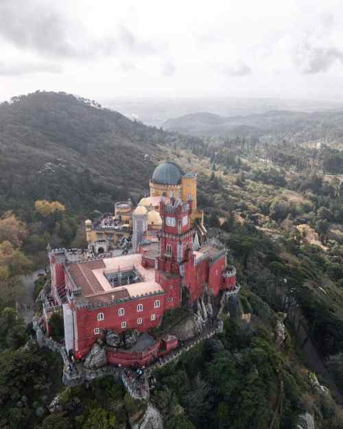 Drone shot with view from above Pena Palace in Sintra, Portugal