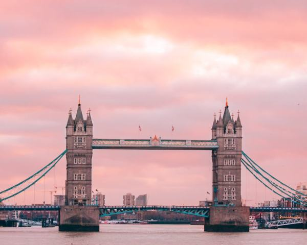 Tower Bridge at sunrise taken from London Bridge. Get all the best London travel tips in this 3 day London itinerary (including the best photo spots in London)