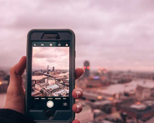Taking a picture of the view from the top of the dome of St. Paul's Cathedral near sunset. Check out this 3 day London itinerary for the best things to do in London and the best London photo spots.