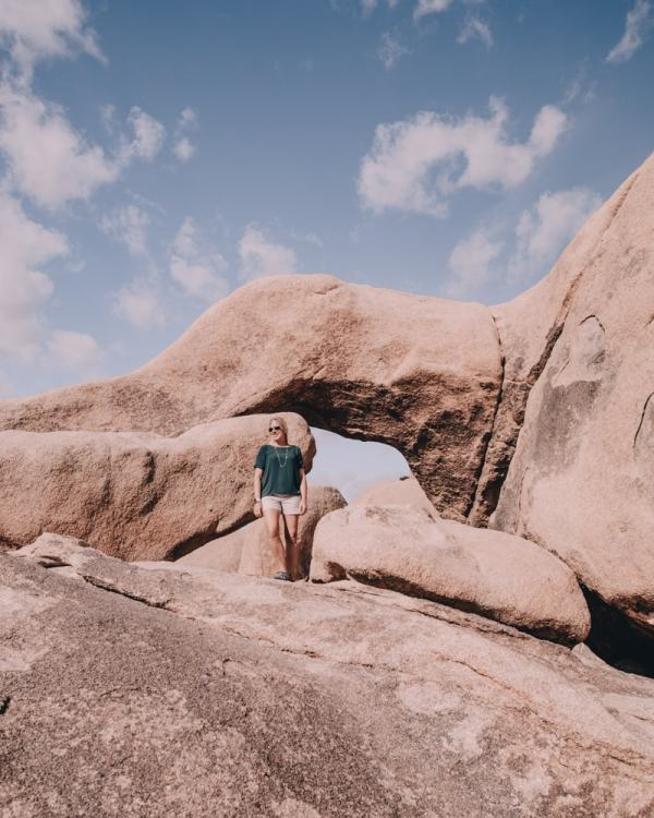 The popular Arch Rock in Joshua Tree National Park. Joshua Tree is the perfect stop on a road trip or for a one day stop, so here is a one day itinerary of all the spots you don't want to miss!