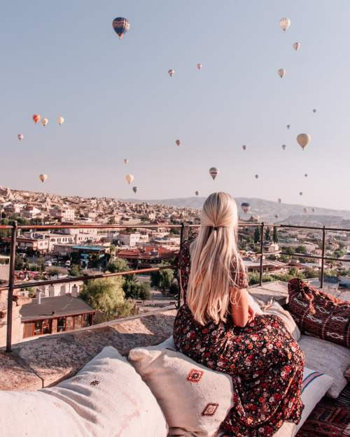 Watching the hot air balloons at sunrise in Cappadocia from Cappadocia Cave Suites.