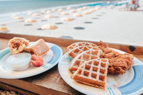 Breakfast burrito and chicken and waffles with a beach view at Boardwalk Bar on the Westgate Cocoa Beach Pier - get a full restaurant review here.