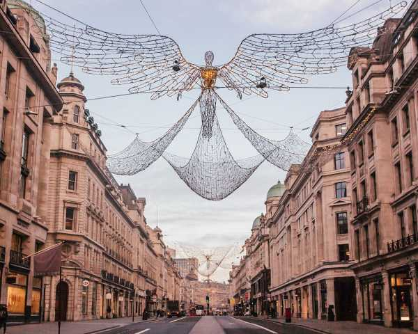 Angels hang across Regent Street at Christmas as part of the Spirit of Christmas display in London. Check out this full guide to Christmas lights in London and get a free map to plan your trip!
