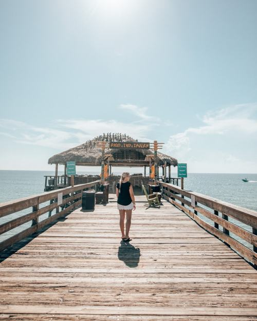 Woman walking towards Rikki Tiki Tavern at the end of the Westgate Cocoa Beach Pier (full review here!)