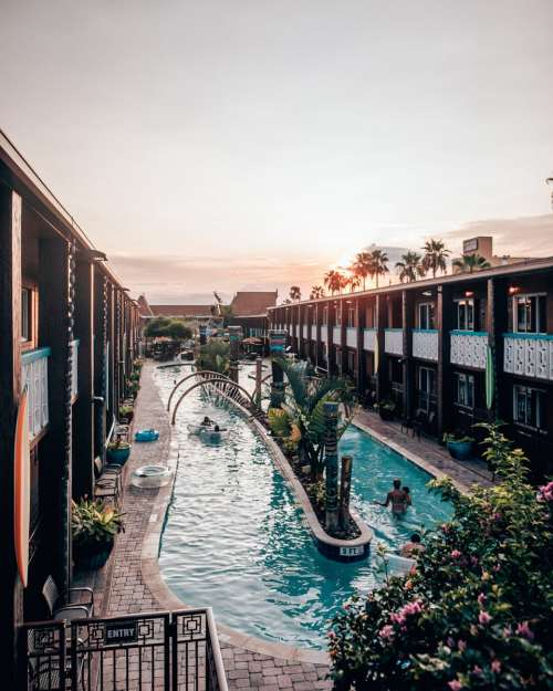 Wakulla Falls Water Park's lazy river at sunset at Westgate Cocoa Beach Resort. Find out why this is the best Florida family vacation resort for a Florida beach vacation.