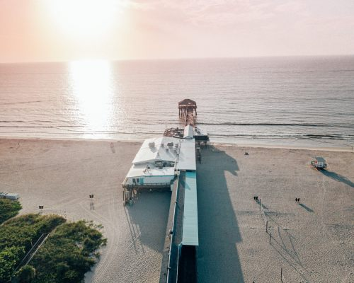 Westgate Cocoa Beach Pier at sunrise from a drone. Find out about the perfect Cocoa Beach vacation here.