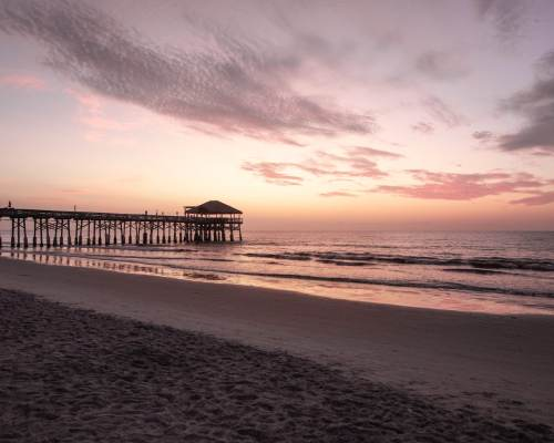 Sunrise at Westgate Cocoa Beach Pier in Cocoa Beach, Florida. Find out everything you need to know for a perfect Cocoa Beach Florida beach vacation.
