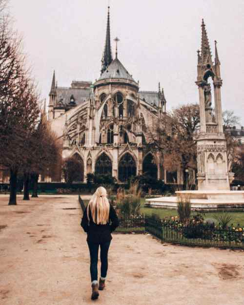 The back of Notre Dame features the flying buttresses. Get all the best Paris winter travel tip in this guide to New Year's in Paris.