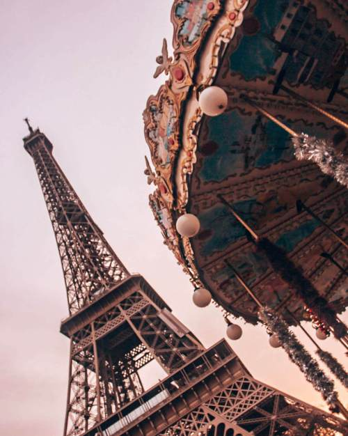 The Eiffel Tower and the carousel across the street by the Pont D'lena in Paris. Get a guide to the best photo spots in Paris at New Year's here.