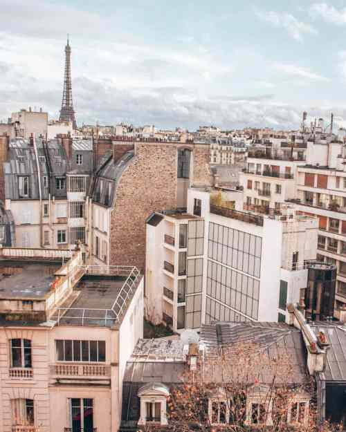 The view of the Eiffel Tower from our Airbnb in Paris. Find the best hotels in Paris with a view in this guide to New Year's in Paris.