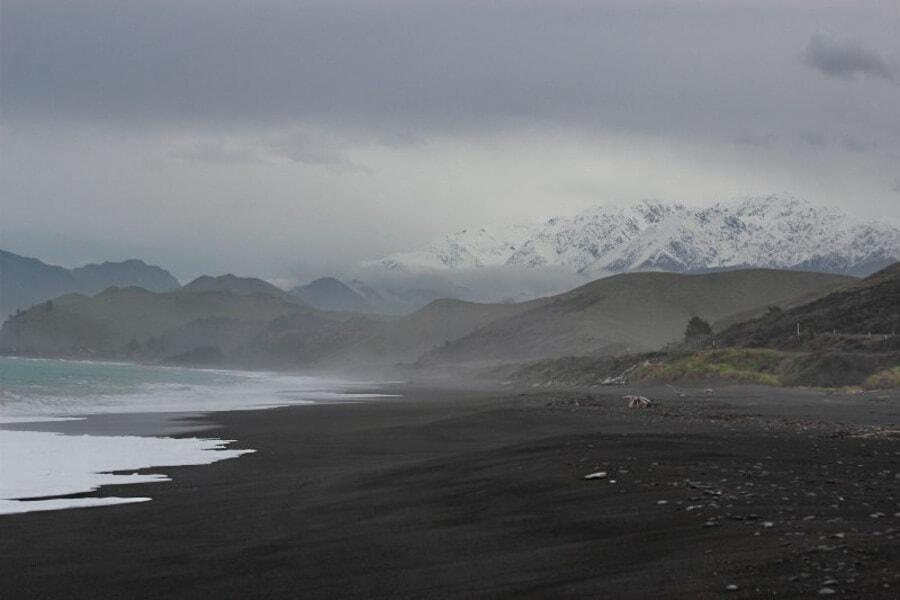 A black sand beach on the east coast the South Island in New Zealand