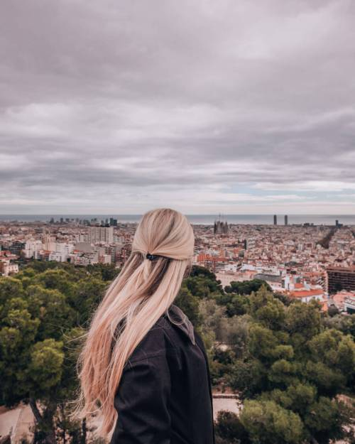 A woman looking out over Barcelona from the free zone at Park Guell