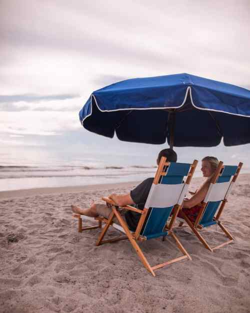 A couple relaxing on the beach at Cocoa Beach in Florida