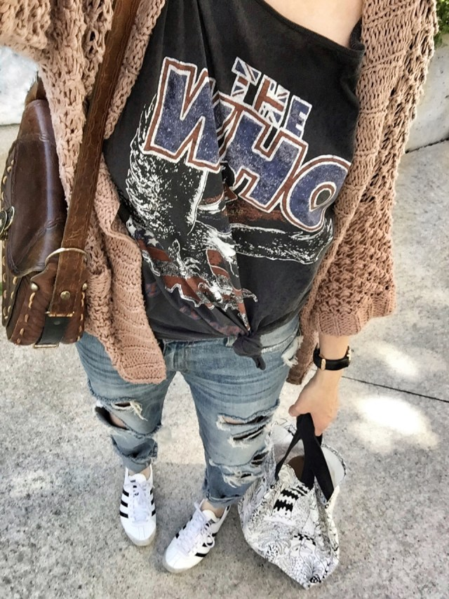 Band tee, oversized cardigan, distressed jeans, and Adidas