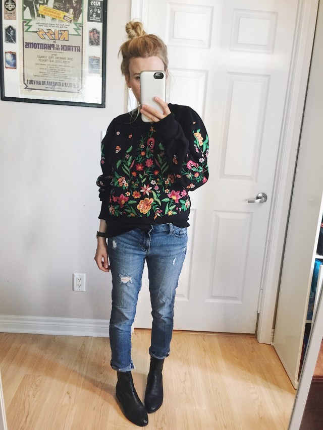 Embroidered sweatshirt, girlfriend jeans, and boots