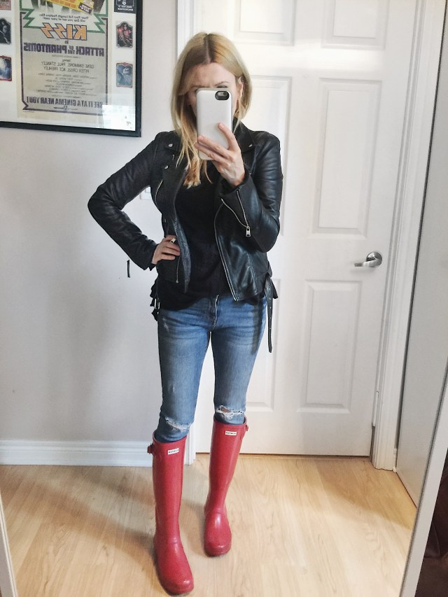 Leather jacket, sweater, skinny jeans, and red hunter boots