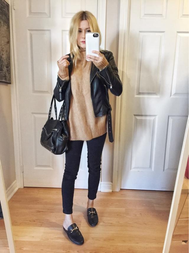 Leather jacket, oversized camel sweater, black pants, mules