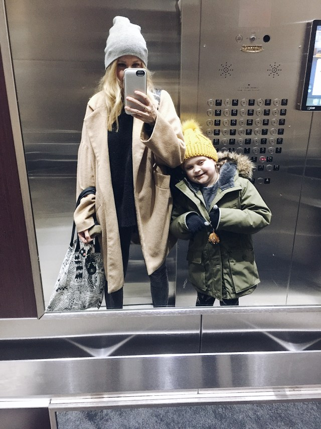Mother daughter elevator selfie