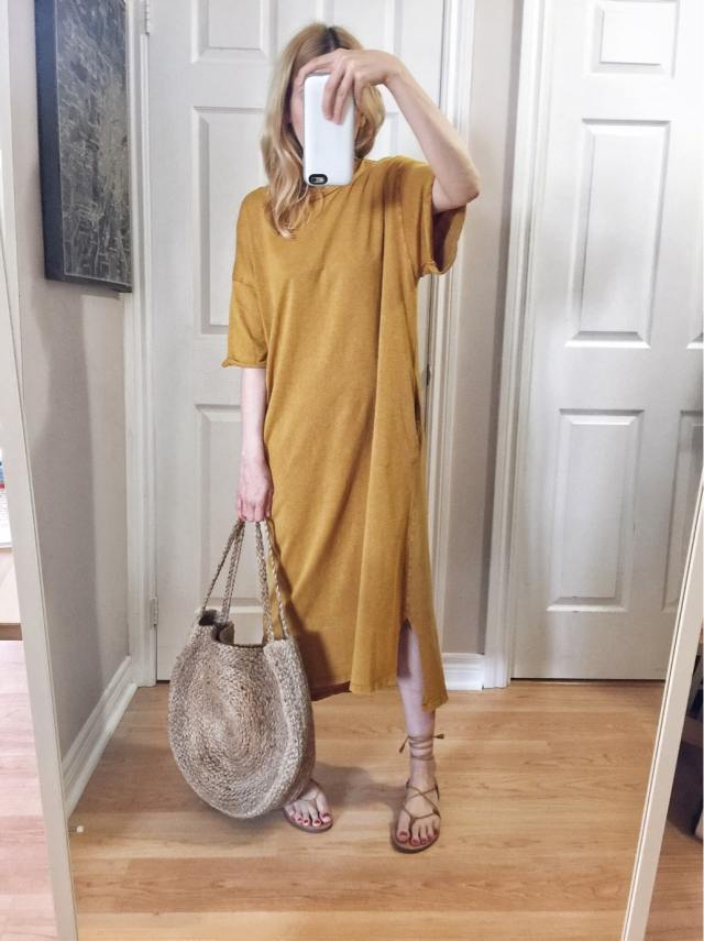 I am wearing a yellow shirtdress, woven circle bag, and Madewell sandals