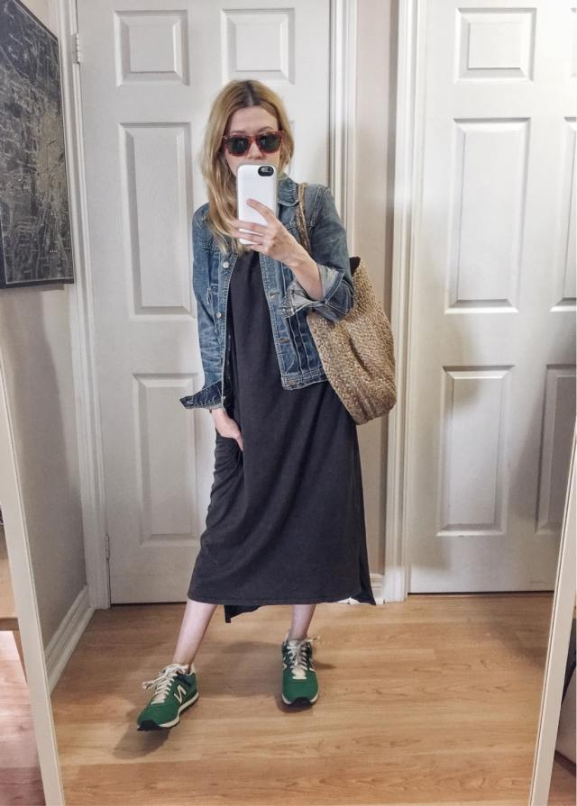 I am wearing a long grey t-shirt dress, old jean jacket, green New Balance, and a woven circle bag