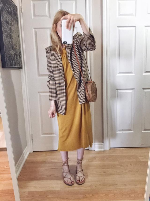 I wearing a t-shirt dress, Zara blazer, a small circle purse, and Madewell Boardwalk sandals