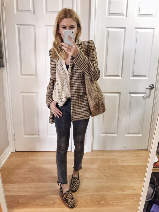 I am wearing a crochet blouse, checkered blazer, a large woven bag, grey jeans, and Sam Edelman animal print loafers.