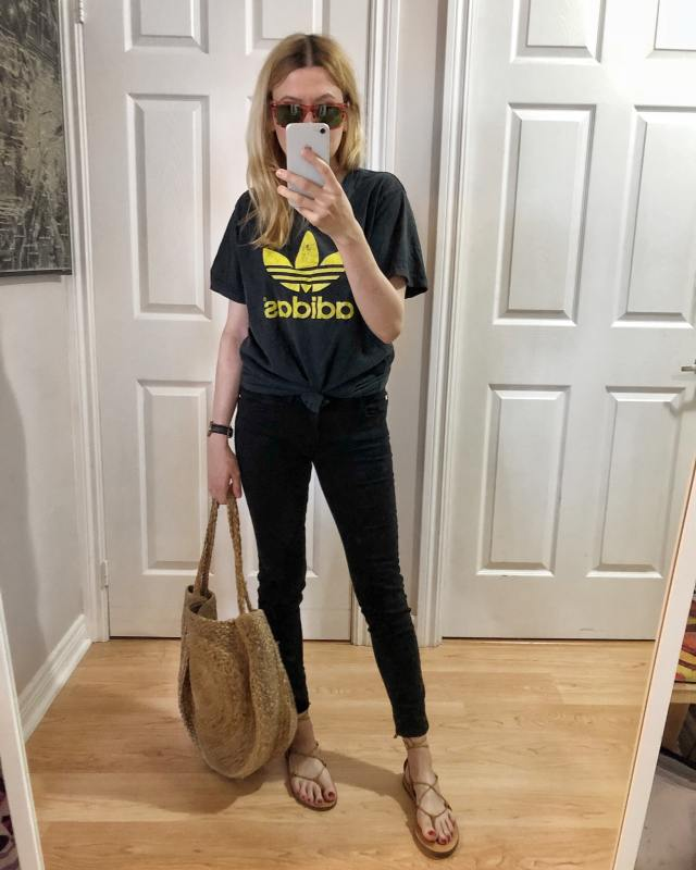 I'm wearing a vintage adidas t-shirt, black jeans, Madewell Boardwalk Sandals, and a large woven circle purse.