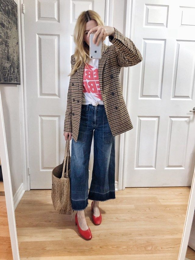 What I wore. I am wearing a Bowie t-shirt, wide leg jeans, a check blazer, and red Everlane Day shoes.