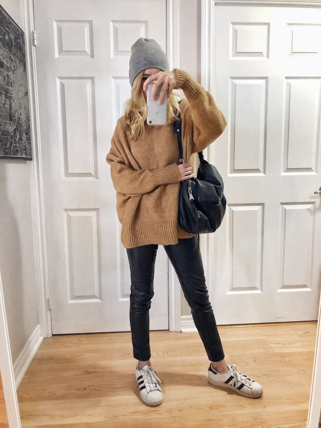 What I wore. I am wearing an oversized sweater, faux leather leggings, and Adidas