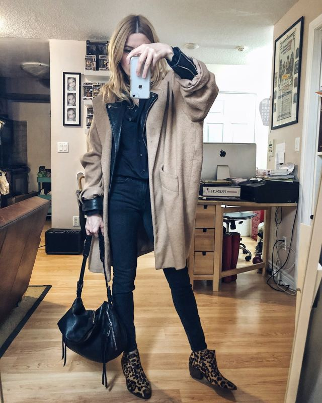 What I Wore. I am wearing a black silk blouse, black jeans, animal print booties, and a Moto jacket layered under an oversized camel coat.