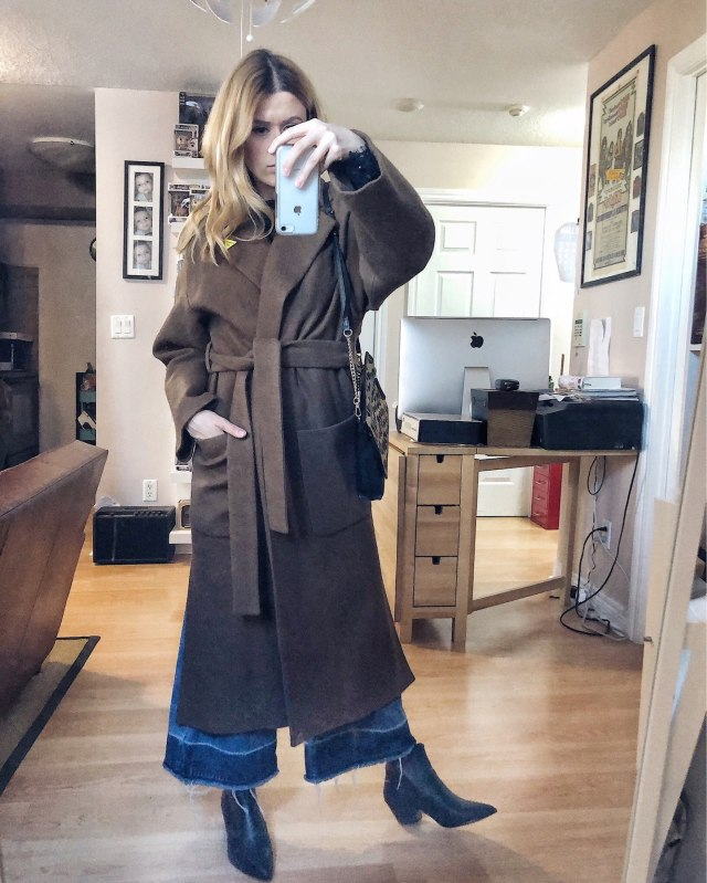 What I Wore. I am wearing a long wool coat, wide leg jeans, and black booties.