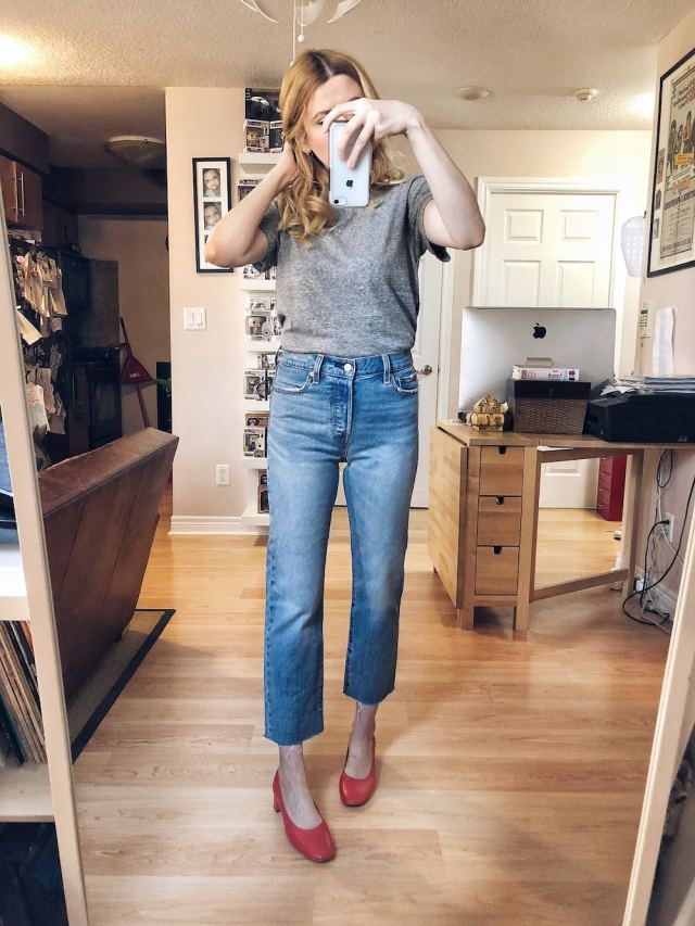 I am wearing a frey Madewell t-shirt, Levi's Wedgie Straight jeans, and a pair of red Everlane Day Heels.