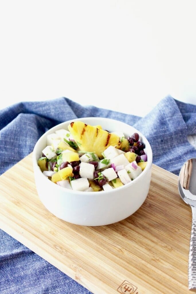 A refreshing grilled pineapple, black bean and jicama salad that is perfect served with grilled meals or used as a salsa! (vegan, gluten-free)   via livelytable.com